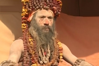 Naga Sadhus, wearing thousands of Rudraksha, a huge draw at Kumbh Mela