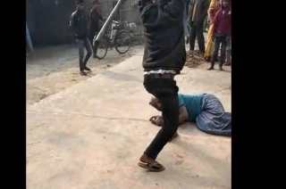 Son beats his own father for selling land, video goes viral on social media