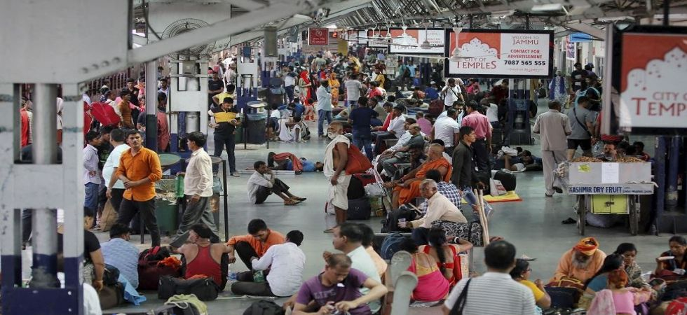 Tourists and passengers wait for their trains as they prepare to leave from Jammu Railway Station (Photo Source: PTI)